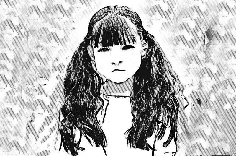 黒板の前の少女